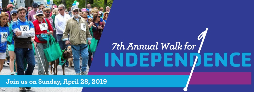 2019 Walk For Independence Banner with walkers at event